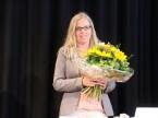 Riceve gli onori in rappresentanza di tutti coloro che hanno lavorato dietro le quinte: Monique Baldinger della segreteria UPSA.
